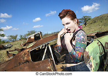 Sexy tattooed woman. - Angry tattooed Caucasian woman with...
