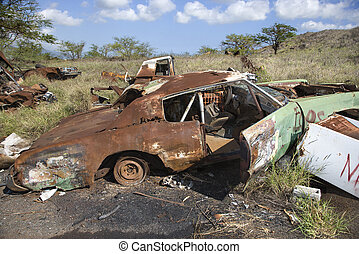Rusty car in junkyard. - Old rusted car in junkyard.