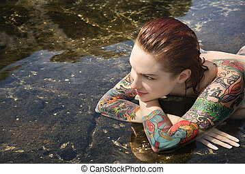 Sexy nude tattooed woman - Sexy nude tattooed Caucasian...