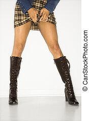 Woman in mini skirt - Portrait of woman pulling up mini...