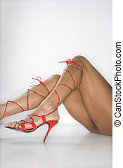 Woman in high heels - Womans legs and feet wearing sexy red...