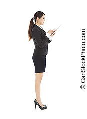side view young  businesswoman holding tablet pc