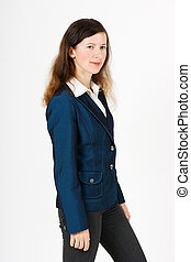 Girl in a blue suit - A young girl in a blue suit standing