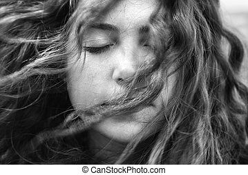 Windblown woman. - Young adult Caucasian female with hair...