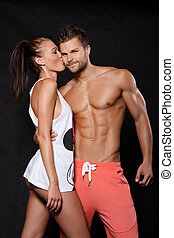 Young couple in love - Young muscular man holding a young...