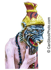 Ascetic statue in Thai style - Clay-like hermit isolated on...
