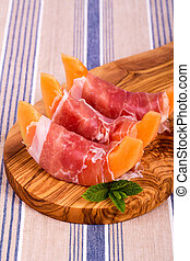 Melon and ham starters - Parma ham and sliced melon starter...