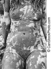 Muddy nude female. - Young adult Caucasian female nude...