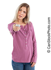 Annoyed woman changing channel on a white background