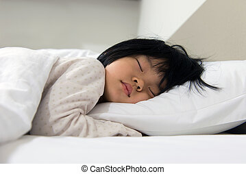 Sleeping child - Portrait of Asian child sleeping on the bed