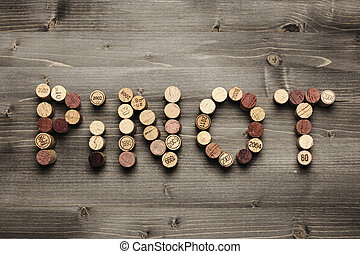 Pinot - PINOT written with corks