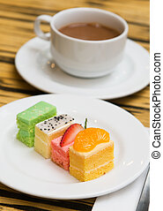Cakes - Assorted types of fruit cakes served in the plate