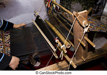 Ancient Chinese loom - Weaver at the old loom in china