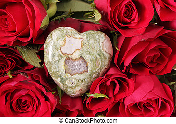 heart  - A heart of gem on red roses