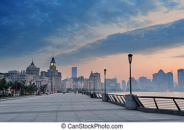 Shanghai Waitan district with historic buildings over river...