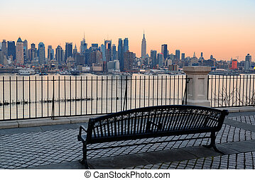 New York City - Bench in park and New York City midtown...
