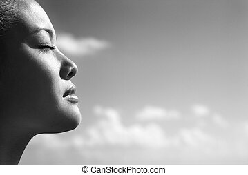 Woman with eyes closed. - Side view of Asian young adult...