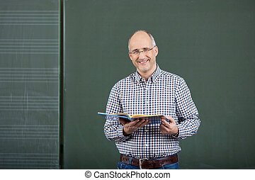 Friendly male teacher teaching form a set of class notes...