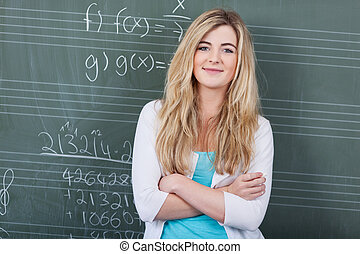 Confident female student in maths class