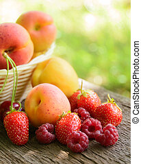 Fresh Ripe Sweet Fruits on the Wooden Table in the Garden....