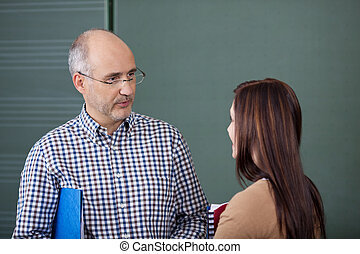 Lecturer and student in a discussion - Middle-aged male...