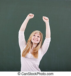 Girl With Arms Raised Celebrating Victory Against Greenboard...