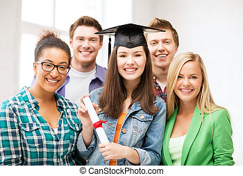 girl in graduation cap with certificate - education and...
