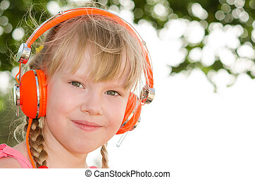 Closeup portrait of cheerful girl listening lesson in...