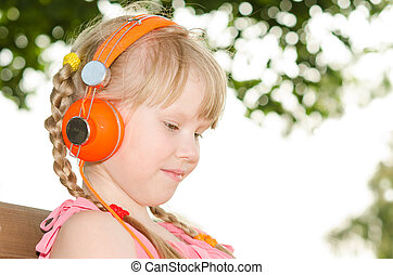 Girl sitting on bench in park and listening language audio...
