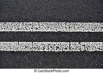 Asphalt road with white double solid line Transportation...