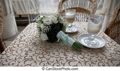 Wedding bouquet on the table - The place where vride and...