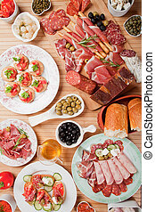 Antipasto food - Table full of antipasto or tapas, appetizer...