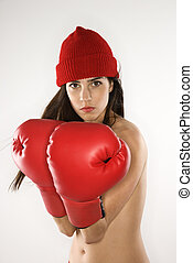 Woman with boxing gloves. - Topless caucasian woman wearing...
