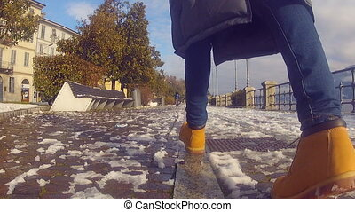Walking down the embankment - Young girl walk down the...