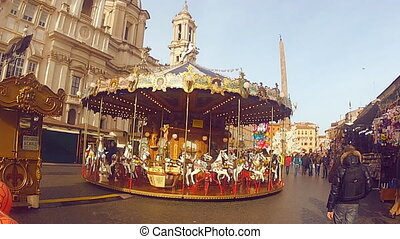 French karousel on Piazza Navona in Rome, Italy