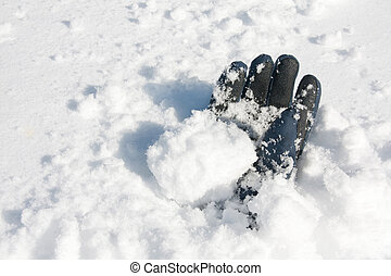 Glove buried in snow after avalanche