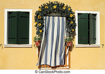 door framed with garland wreath
