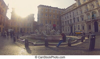 Piazza Navona in Rome - Young guy reads a book on Piazza...