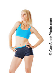 Blonde woman after her fitness program smiling