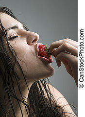 Woman biting strawberry - Topless caucasian woman biting a...