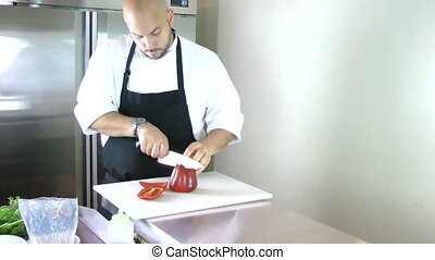 chef cutting peppers for salad