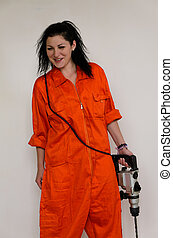 Capable woman with an electric drill