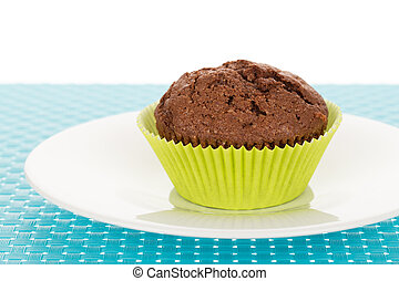 Muffin on plate - Delicious homemade chocolate muffin on...