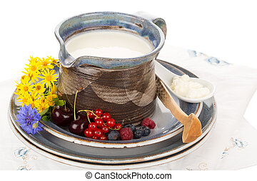 Kefir in jug - Kefir in argil jug with wooden spoon on...