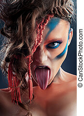 wild makeup - Art photo of a stressed ethnic woman with...