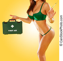 Sexy woman carrying a first aid kit - Sexy woman in green...
