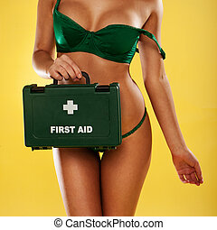 Sexy busty woman with a first aid kit - Sexy busty woman...