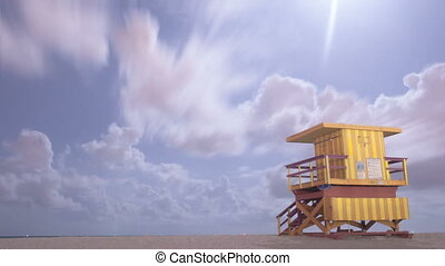 timelapse of miami beach sky with lifeguard house