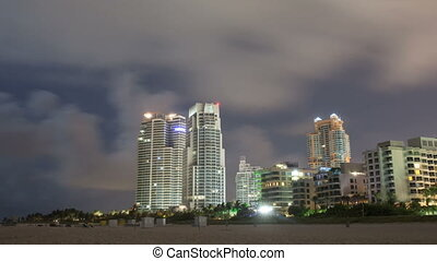 timelapse of miami beach at night city buildings