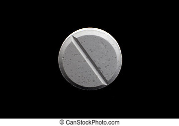 pills - Single white pill isolated on black background